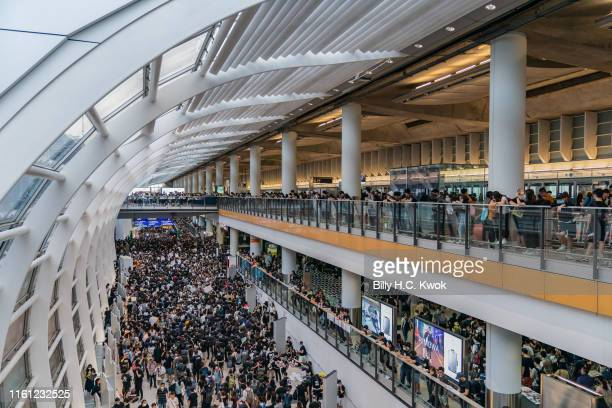 Protesters occupy the Hong Kong International Airport during a demonstration on August 12 2019 in Hong Kong China Prodemocracy protesters have...