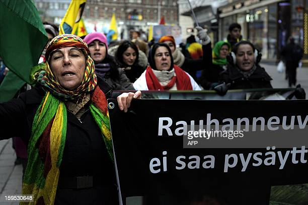Protesters of Kurdish origin gather in Helsinki on January 15 2013 to protest after the killing of three Kurdish activists in Paris The jailed leader...