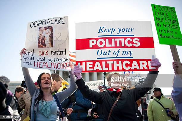 Protesters of President Barack Obama's healthcare law rally in front of the Supreme Court on the second day of legal arguments over the Affordable...