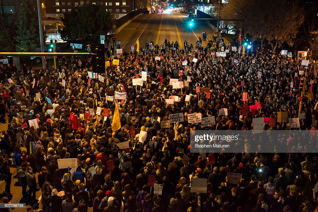 Protesters of President-elect Donald Trump gather in an intersection outside the Humphrey School of Affairs on the campus of the University of Minnesota on November 10, 2016 in Minneapolis, Minnesota. Thousands of people across the country have taken to the streets in protest in the days following the election of Republican Donald Trump over Democrat Hillary Clinton.