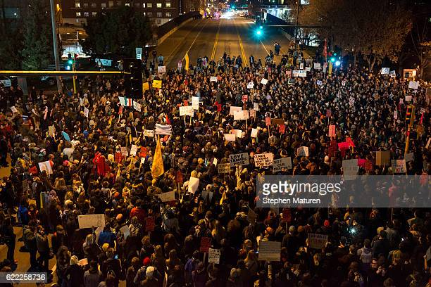 Protesters of President-elect Donald Trump gather in an intersection outside the Humphrey School of Affairs on the campus of the University of...