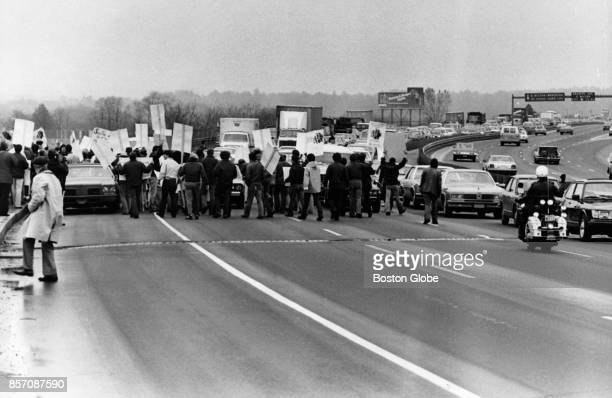 Protesters of Proposition 2½ stand along the Quincy side of the expressway near Neponset in Boston April 29 1981