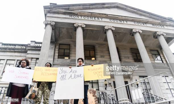 Protesters of the Black Women's Blueprint are seen outside the Montgomery County Courthouse during the first day of Jury Selection for Bill Cosby's...