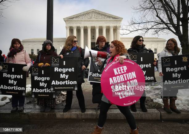 Protesters on both sides of the abortion issue gather in front of the U.S. Supreme Court building during the Right To Life March, on January 18, 2019...