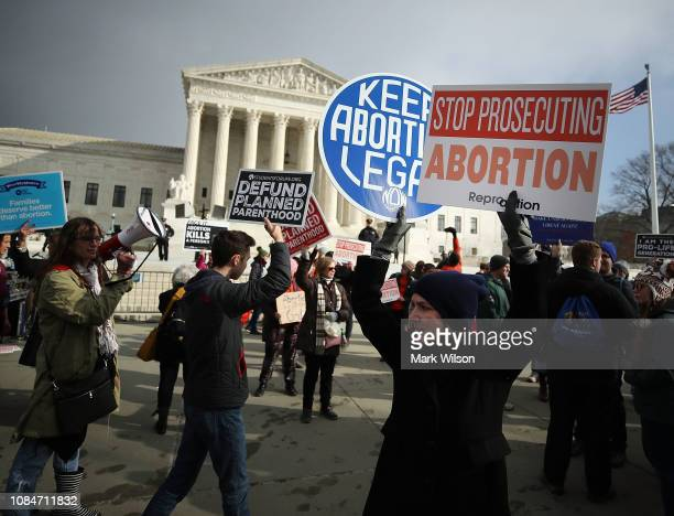 Protesters on both sides of the abortion issue gather in front of the US Supreme Court building during the Right To Life March on January 18 2019 in...