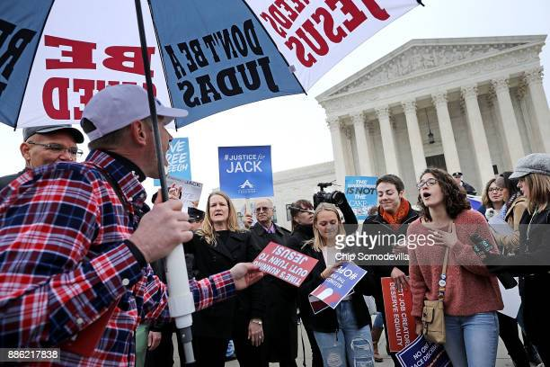Protesters on both sides of the issue argue in front of the Supreme Court building on the day the court is to hear the case Masterpiece Cakeshop v...