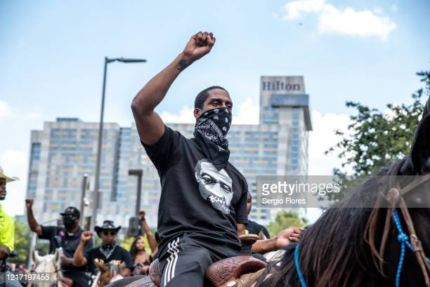 Protesters on horseback make their way toward city hall during a march in honor of George Floyd on June 2 2020 in Houston Texas Members of George...