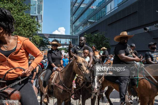 Protesters on horseback march in honor of George Floyd on June 2 2020 in Houston Texas Members of George Floyd's family participated in a march that...