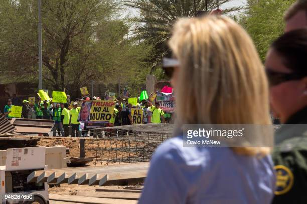 Protesters on the Mexico side of the border demonstrate against policies of President Donald Trump as US Department of Homeland Security Secretary...