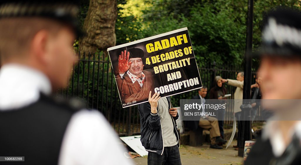 Protesters opposed to Libyan leader Moamer Kadhafi demonstrate outside of the London School of Economics (LSE) as Seif al-Islam Alqadhafi (unseen), son of Libyan leader Moamer Kadhafi, delivers a speech in London on May 25, 2010.