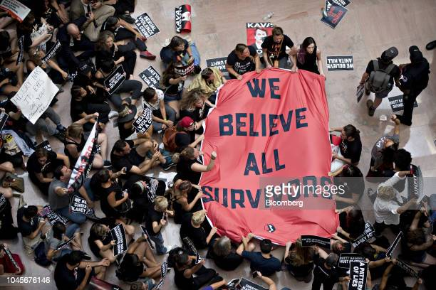 Protesters opposed to Supreme Court nominee Brett Kavanaugh hold a We Believe Survivors banner in the Hart Senate Office building in Washington DC US...