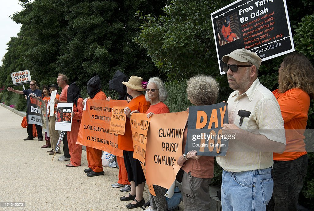 Protesters outside of the Hart Senate Office Building in Washington, D.C. protest the hearing to examine closing Guantanamo, focusing on the national security, fiscal and human rights implications. The hearing was being held by the judiciary subcommittee on constitution, civil rights & human rights on July 24, 2013.