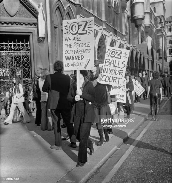 Protesters outside the court during the appeal in the Oz magazine obscenity trial, London, UK, November 1971. One placard reads 'We are the people...