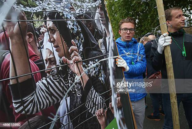 Protesters outside the Kloster Banz congress center demonstrate against the arrival of Hungarian Prime Minister Viktor Orban at a meeting of the CSU...