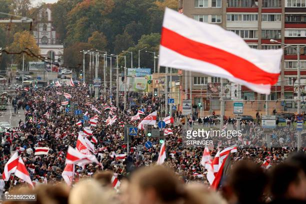 Protesters parade through the streets during a rally demanding to free jailed activists of the opposition in Minsk on October 4 2020 Belarusian...