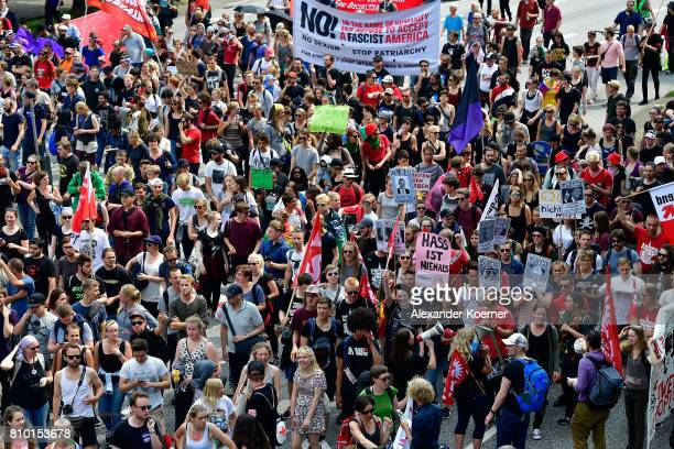 Protesters partcipate in a peaceful antiG20 march on July 7 2017 in Hamburg Germany Authorities are braced for largescale and disruptive protests as...