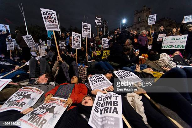 """Protesters participate in a """"Die In"""" protest in Parliament Square on December 2, 2015 in London, England. Ritish MPs are expected to vote tonight on..."""