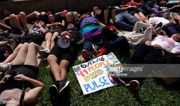 Protesters participate in a diein to mark the anniversary of the Pulse nightclub shooting Tuesday June 12 in West Palm Beach across the water from...