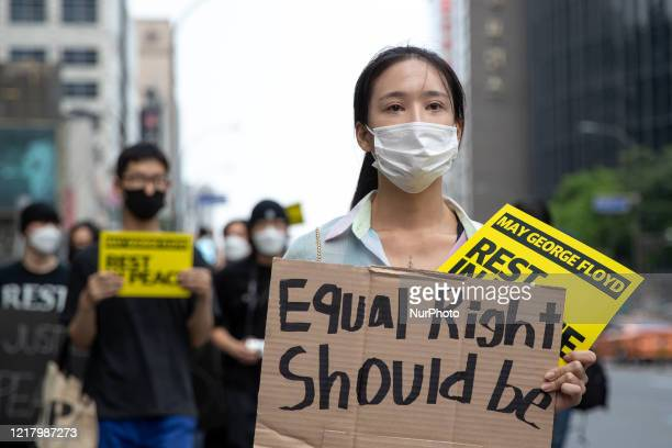 Protesters participate in a protest in Seoul to show solidarity with Black Lives Matter demonstrations in the US, which were sparked by the death of...