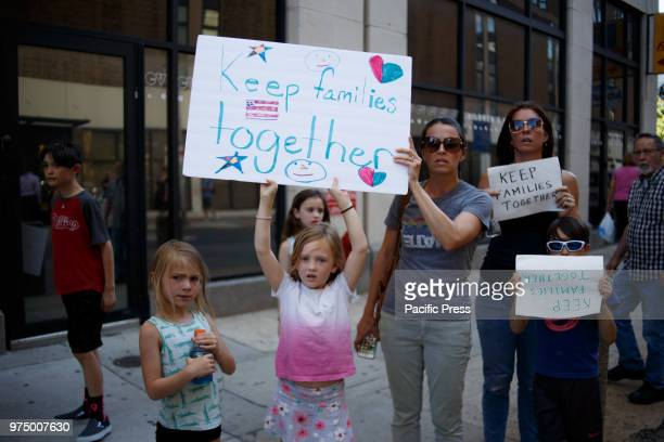Protesters participate in a rally organized by Families Belong Together speaking out against the Trump administration's policies separating immigrant...