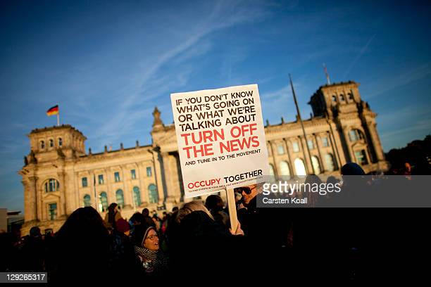 Protesters participate in demonstrations against the influence of bankers and financiers in front of the Reichstag building on October 15 2011 in...