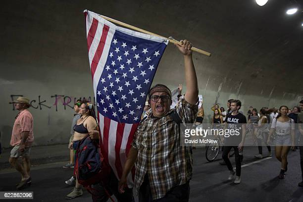 Protesters pass through a tunnel as the march in reaction to the upset election of Republican Donald Trump over Democrat Hillary Clinton in the race...