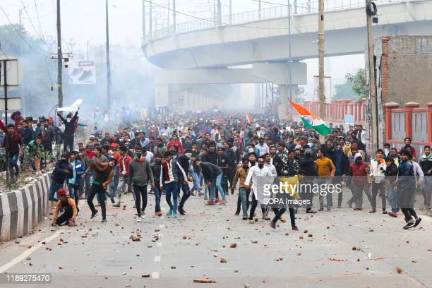 Protesters pelt stones towards the police during the demonstration. Citizen and students of different universities and educational institutions and...