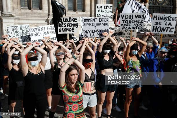 """Protesters perform a dance inspired by the Chilean feminist group """"Las Tesis"""" during a demonstration called by feminist movements in front of the..."""