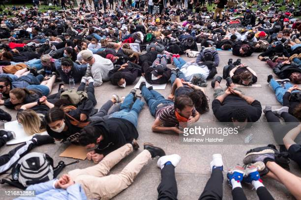 Protesters perform a mass 'die-in' in front of the Ohio Statehouse at the exact time George Floyd died on May 25 in Minneapolis police custody, on...