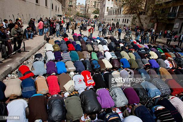 Protesters perform friday praying during a break of the clashes between protesters and egyptian riot police near the interior ministry February 3...