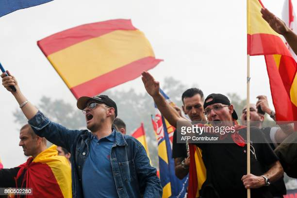 Protesters perform the fascist salute during an ultraright wing antiseparatist demonstration for the unity of Spain called by 'Falange Espanola'...