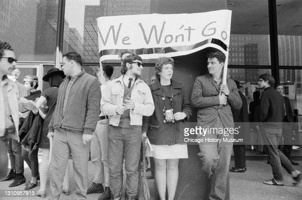 Protesters picket and burn draft cards in front of the Federal Building, 230 South Dearborn Street, Chicago, Illinois, June 1, 1967.