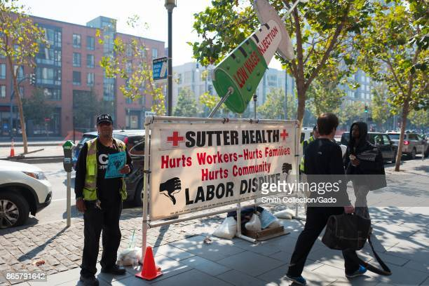 Protesters picket outside an office of Sutter Health during a labor dispute in the South of Market neighborhood of San Francisco California October...