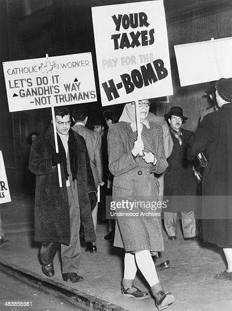 Protesters picketing against the use of tax dollars for the development of nuclear weapons, March 1950.