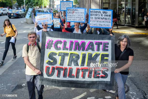 Protesters picketing Members of the Stop the Williams Pipeline Coalition gathered with signs and banners outside National Grid Corporate Headquarters...