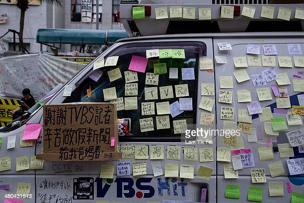 Protesters post anti-media slogans on a van which belongs to a TV station known for being pro-government, during rally outside the legislature on...