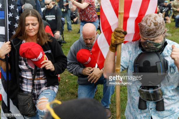 Protesters pray as the Proud Boys a rightwing proTrump group gather with their allies in a rally called âEnd Domestic Terrorismâ against Antifa in...