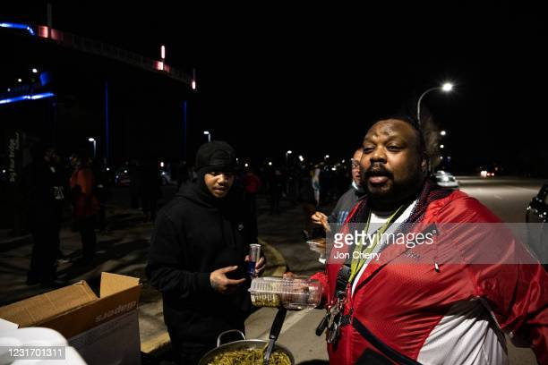 Protesters prepare and serve food from the bed of a truck at night after the Breonna Taylor memorial events on March 13, 2021 in Louisville,...