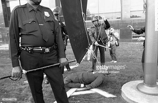 Protesters prepare to hang an effigy of Ronald Regan at a protest organized by AIDS activist group ACT UP at the headquarters of the Food and Drug...