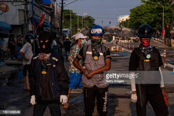 Protesters prepare to use molotov cocktails against military junta forces on March 16, 2021 in Yangon, Myanmar. Myanmar's military Junta charged...
