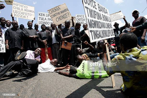 Protesters pretend to weep in Lilongwe on October 10 during a demonstration called by Consumers' Association of Malawi Executive Director John Kapito...