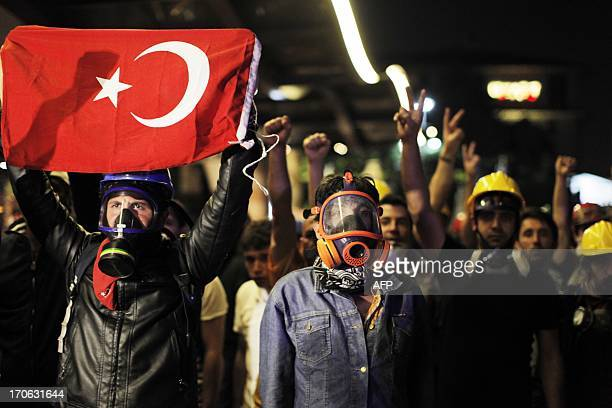 Protesters protest near Gezi Park in Istanbul June 15 2013 Turkish police stormed an Istanbul park on Saturday after protesters defied an ultimatum...