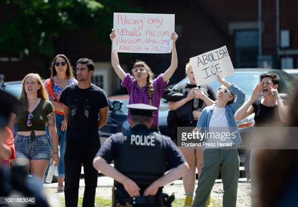 Protesters protesting the visits of Attorney General Jeff Sessions stand near the entrance to the garage at 100 Middle St in Portland where Sessions...