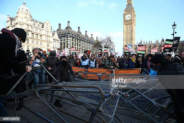Protesters pull barriers apart in Parliament Square during a demonstration against fees and cuts in the education system on November 19 2014 in...