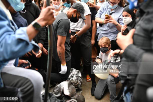 Protesters pull down a statue of Edward Colston during a Black Lives Matter protest rally in College Green Bristol in memory of George Floyd who was...