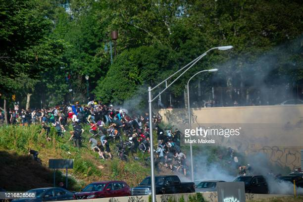 protesters race up a hill after being shot by tear gas after a march through Center City on June 1 2020 in Philadelphia Pennsylvania Demonstrations...