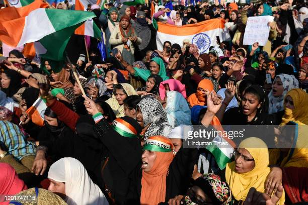 Protesters raise slogans and wave the tricolor ahead of their march to Home Minister Amit Shah's residence, at Shaheen Bagh, on February 16, 2020 in...