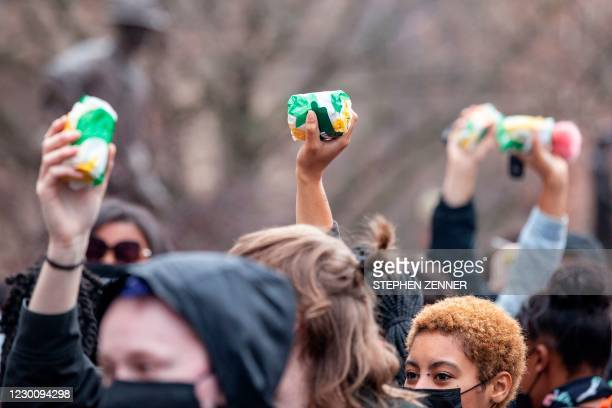 Protesters raise Subway sandwiches during a demonstration for Casey Goodson Jr. In front of the Ohio Statehouse in Columbus, Ohio on December 12,...