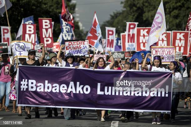 Protesters raise their fists as they march on the streets to commemorate the 46th anniversary of the declaration of martial law by the late dictator...