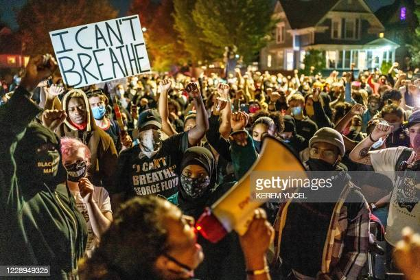 Protesters raise their fists during a demonstration after the release on bail of former police officer, Derek Chauvin, in Minneapolis, Minnesota, on...